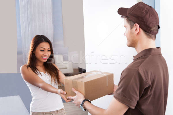 Woman Receiving Courier From Delivery Man Stock photo © AndreyPopov