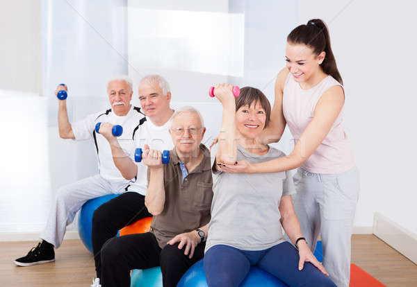 Trainer Assisting Senior People At Healthclub Stock photo © AndreyPopov