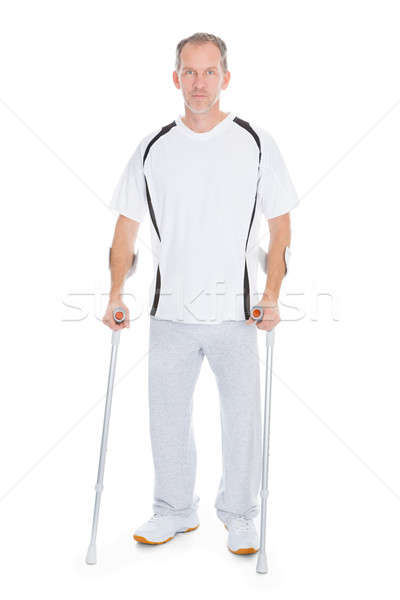 Mature Man With Crutches Stock photo © AndreyPopov