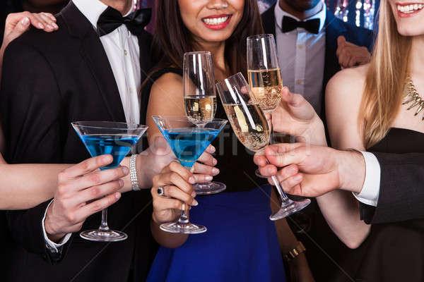 Friends Toasting Drinks At Nightclub Stock photo © AndreyPopov