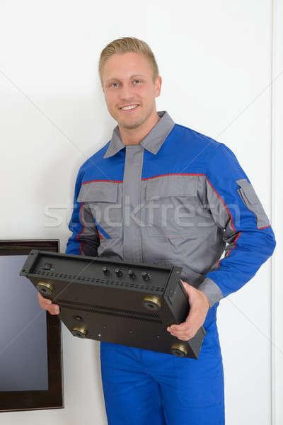Technician Holding Amplifier Stock photo © AndreyPopov