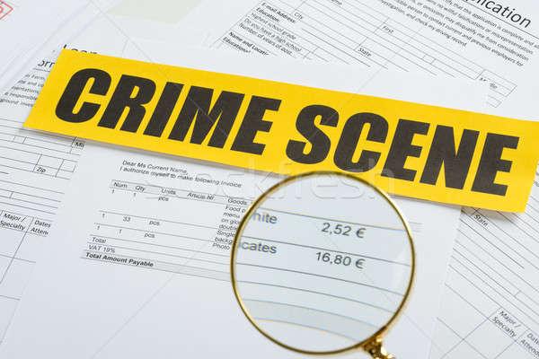 Nagyító iratok bűnügyi helyszín szalag közelkép citromsárga Stock fotó © AndreyPopov
