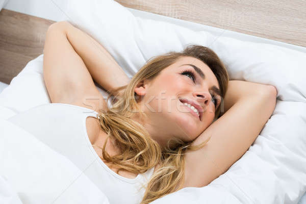 Young Woman Daydreaming Stock photo © AndreyPopov