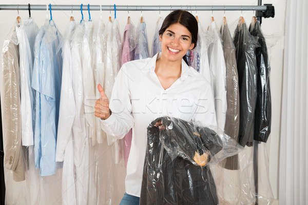 Woman Holding Suit In Shop Stock photo © AndreyPopov