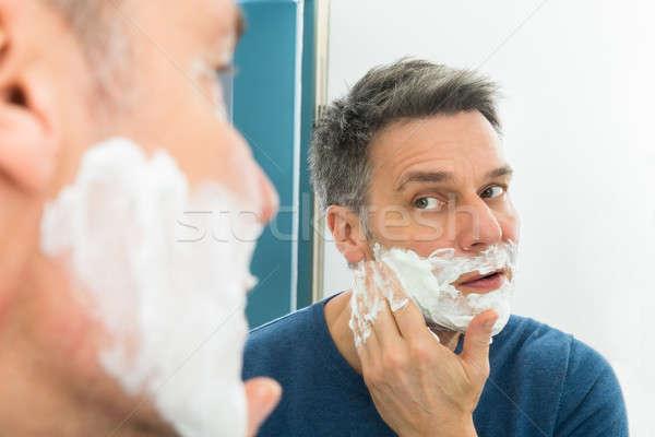 Man Applying Shaving Cream Stock photo © AndreyPopov