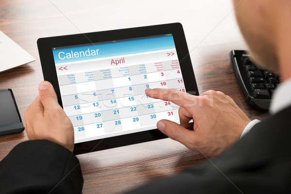 Businessman Using Calendar On Digital Tablet Stock photo © AndreyPopov