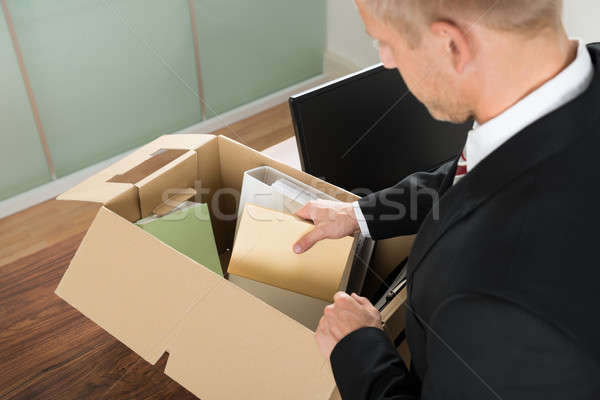 Businessman Packing Files In Cardboard Box Stock photo © AndreyPopov