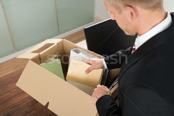 üzletember csomagol akták kartondoboz közelkép iroda Stock fotó © AndreyPopov