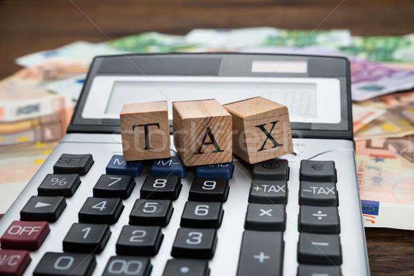 Tax Word On Wooden Blocks Over Calculator Stock photo © AndreyPopov