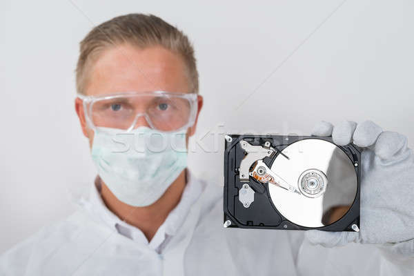 Technician Showing Hard Drive Stock photo © AndreyPopov