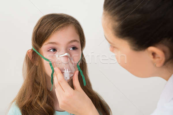 Doctor Holding Inhaler Mask For Girl Breathing Stock photo © AndreyPopov