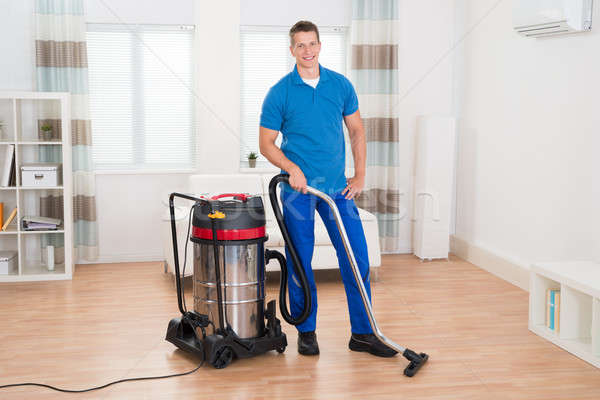 Male Janitor Vacuuming Floor Stock photo © AndreyPopov