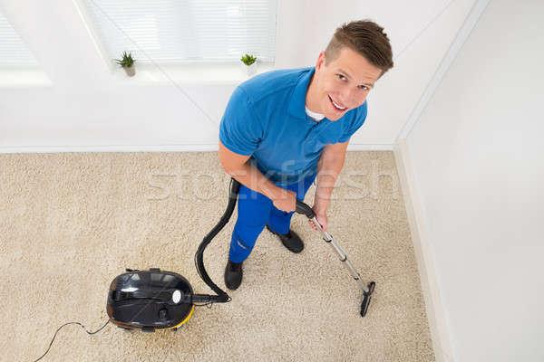 Worker Vacuuming Carpet Stock photo © AndreyPopov