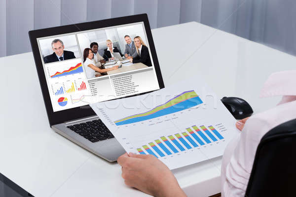 Businessperson Videoconferencing On Laptop Stock photo © AndreyPopov
