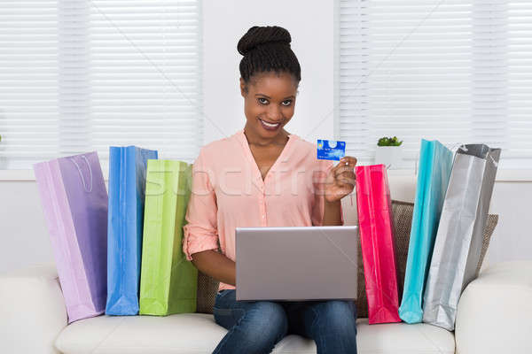 Woman Using Debit Card For Shopping On Laptop Stock photo © AndreyPopov
