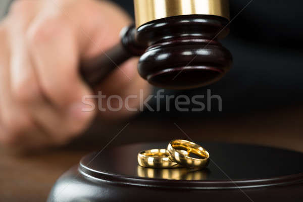 Divorce Judge Hitting Gavel On Golden Rings At Desk Stock photo © AndreyPopov