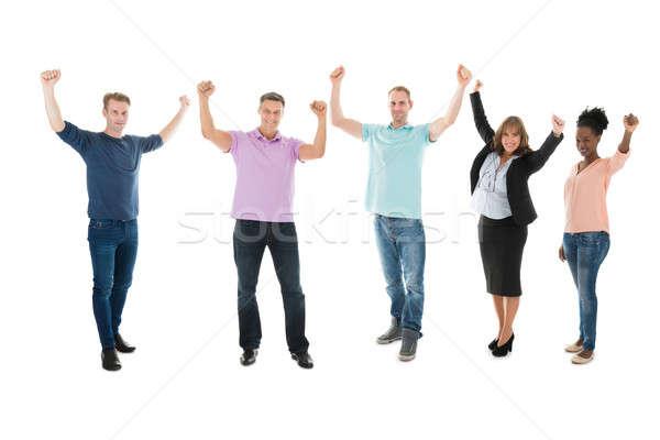 Kreatív üzleti csapat karok a magasban ünnepel siker teljes alakos Stock fotó © AndreyPopov