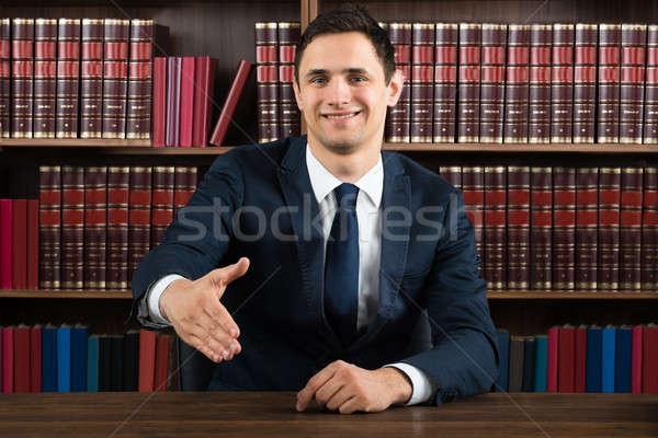 улыбаясь адвокат предлагающий рукопожатие столе портрет Сток-фото © AndreyPopov