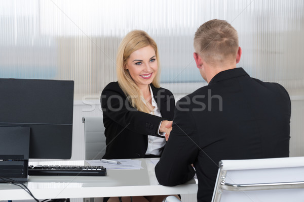 Femme d'affaires serrer la main Homme candidat bureau souriant Photo stock © AndreyPopov