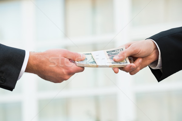 Businessman Giving Bribe To Partner Stock photo © AndreyPopov