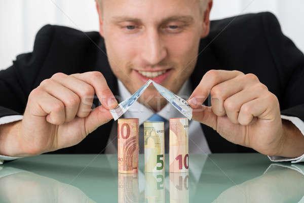 Stock fotó: üzletember · készít · ház · bankjegyek · közelkép · fiatal