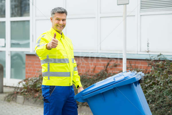 Working Man Holding Dustbin On Street Stock photo © AndreyPopov