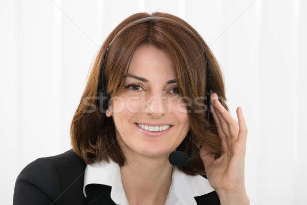 Businesswoman Talking On Headphone Stock photo © AndreyPopov