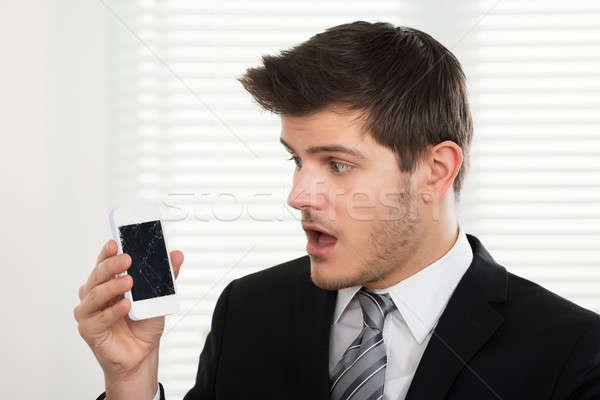 Infelice imprenditore guardando rotto cellulare giovani Foto d'archivio © AndreyPopov