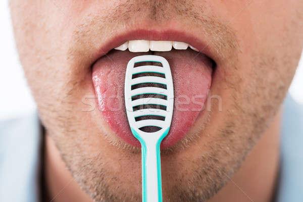 Uomo pulizia lingua primo piano giovane bocca Foto d'archivio © AndreyPopov