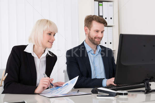 Two Businesspeople Working On Computer Stock photo © AndreyPopov