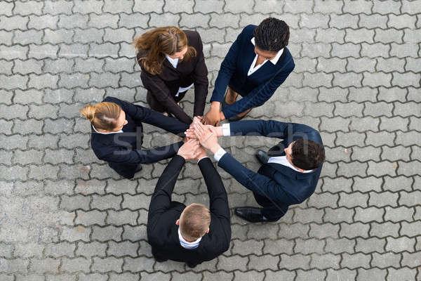 Stock fotó: üzletemberek · kezek · magasról · fotózva · kilátás · nő · barátok