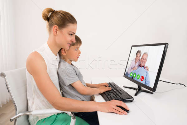 Mother And Son Videoconferencing Stock photo © AndreyPopov