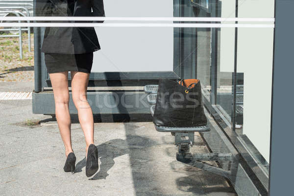 Businesswoman Walking Forward With Handbag Left On Bench Stock photo © AndreyPopov