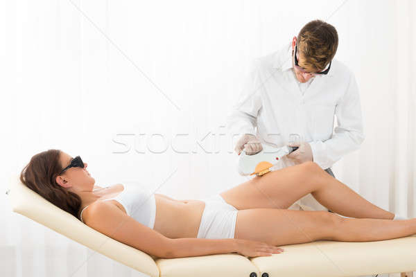 Woman Receiving Laser Hair Removal Stock photo © AndreyPopov