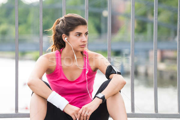 Contemplated Fitness Woman Listening To Music Stock photo © AndreyPopov