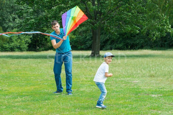 Filho pai voador pipa colorido pai Foto stock © AndreyPopov