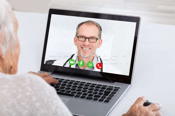 Senior Woman Video Conferencing On Laptop Stock photo © AndreyPopov