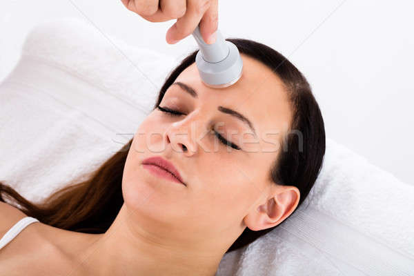 Woman Receiving Microdermabrasion Therapy On Forehead Stock photo © AndreyPopov