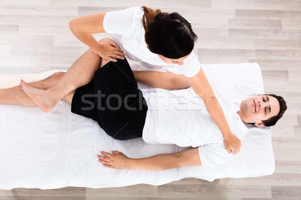 Genç kadın terapist bacak Stok fotoğraf © AndreyPopov