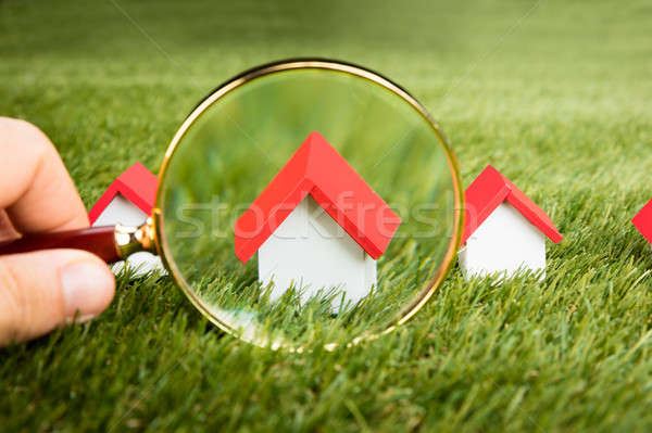 Magnifying Glass Inspecting A Model House Stock photo © AndreyPopov