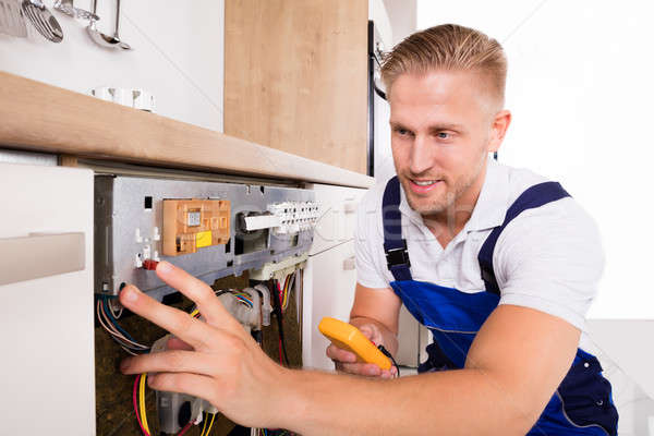 Male Technician Fixing Dishwasher Stock photo © AndreyPopov