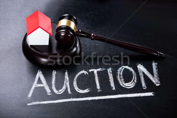 House Model With Gavel On Blackboard Stock photo © AndreyPopov