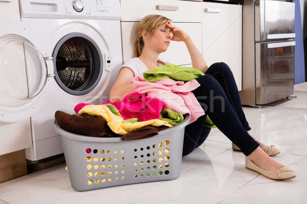 Exhausted Woman Sitting Near Washing Machine Stock photo © AndreyPopov