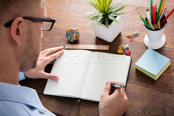 Person Writing Note In Diary Stock photo © AndreyPopov