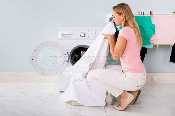 Woman With Cleaned Clothes Near The Electronic Washer Stock photo © AndreyPopov