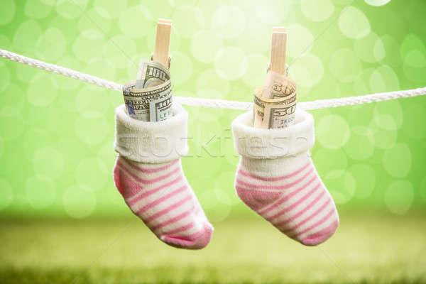 Paar baby sok dollar opknoping touw Stockfoto © AndreyPopov