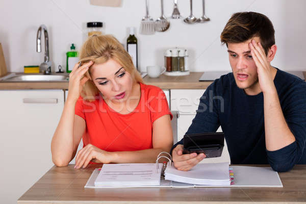 Worried Couple Calculating Their Bills Stock photo © AndreyPopov