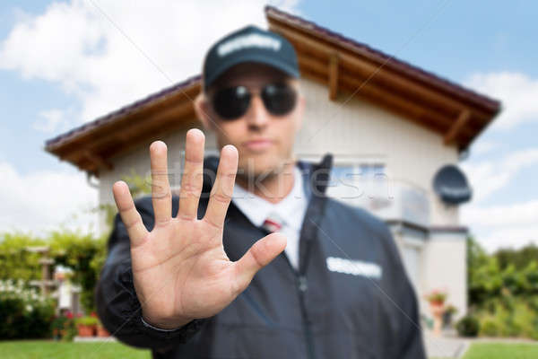 Male Security Guard Making Stop Gesture Stock photo © AndreyPopov