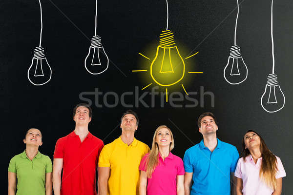 People Looking Up At Bright Idea Concept On Blackboard Stock photo © AndreyPopov