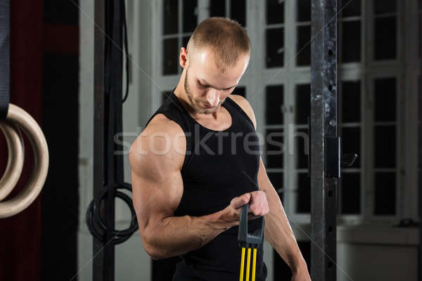Man Doing Exercise With Elastic Resistance Band Stock photo © AndreyPopov